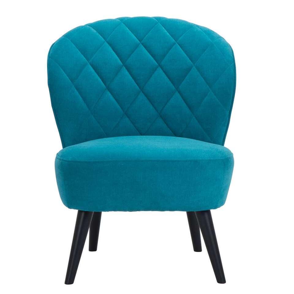 De Vita is een retro look fauteuil die absoluut niet mag ontbreken in je inrichting! Deze mooie vormgegeven fauteuil is uitgevoerd in een fijne, turquoise Oinoco stof met zwarte poot.