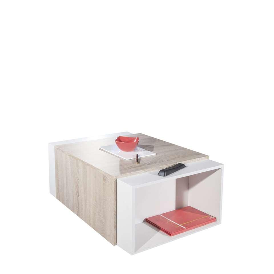 Salontafel Halse is een uitschuifbare salontafel in wit/eikenkleur met opbergmogelijkheid. Verdubbel gemakkelijk het tafelbladoppervlak door de twee gedeelten uit elkaar te schuiven.
