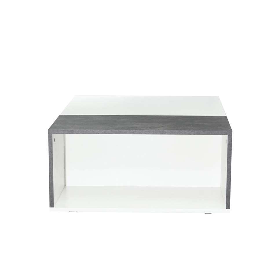 Salontafel Krossen is een tweekleurige, moderne salontafel Krossen in wit met betongrijs. Het open vak kun je gebruiken als opbergruimte