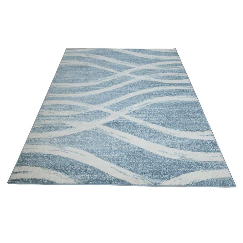 Vloerkleed Florence is een fijn geweven vloerkleed met een golvend dessin.