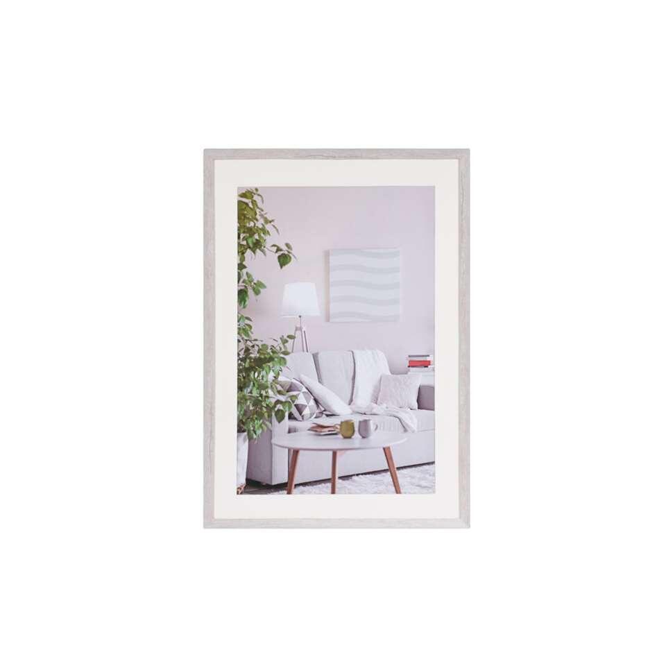 Fotolijst Modern 50 x 70 cm in de kleur wit  van het merk Henzo is een eigentijdse fotolijst voor ieder interieur. Strak vormgegeven in verschillende actuele kleuren verkrijgbaar.